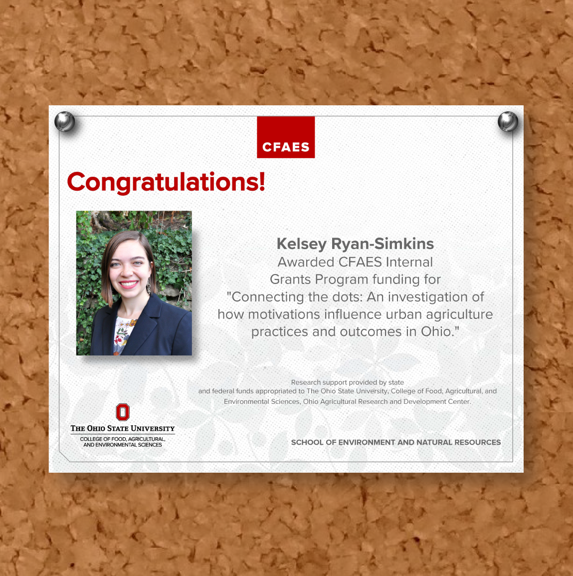 Image shows bulletin board note of congratulations to Kelsey Ryan-Simkins for funding award.