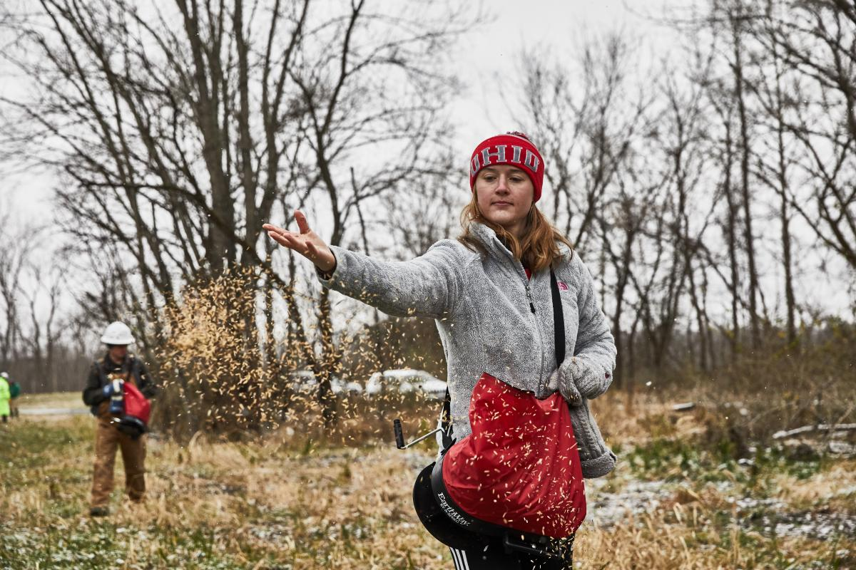 Lizzie Wilson, an environmental science major in the SENR helped with the initial rights-of-way seeding with partners at Three Creeks Metro Park. Photo credit: Emily Stibbs