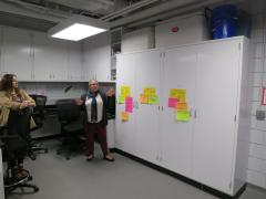 Suzanne Gray giving Staff a tour of her lab