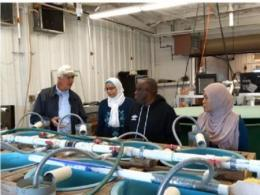 International scholars at The Ohio State University visited the Kentucky State University Aquaculture Center in Frankfort, KY.   Dr. Ken Semmens explains the function of their hatchery system (October 19, 2018).