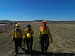 Members of the ADFER Lab participated in the controlled burn. Shown left to right are Rachael Glover (PhD ENR), Jo Kingsbury (PhD ESGP) and Julie Slater (MS ENR).  Photo courtesy of Matt Davies.
