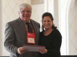 Richard Moore received the Public Policy Award from AAA president Alisse Waterston. Photo credits: Josh Gold.