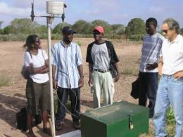 Professor Richard Dick (far right) with PhD students and collaborating Senegalese scientist at long-term research site