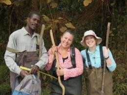 Kiberu Mutebi, Suzanne Gray, and Tiffany Atkinson during a sampling day at the Ndyabusole swamps in Uganda, Africa. Photo Credit: Suzanne Gray.