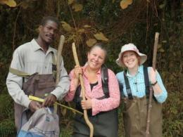 Kiberu Mutebi, Suzanne Gray, and Tiffany Atkinson during a sampling day at the Ndyabusole swamps in Uganda, Africa. Photo Credit: Suzanne Gray.